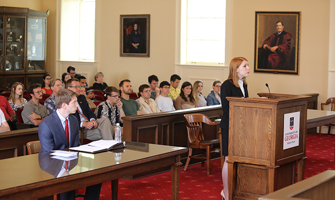 student speaks in courtroom at podium