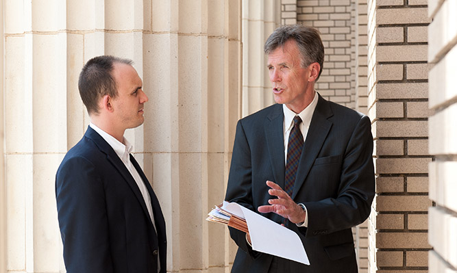 student and law professor discussing clinic work