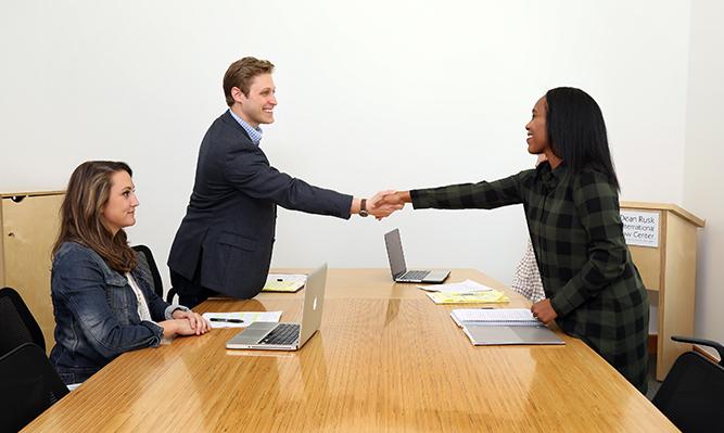 students negotiating a transaction